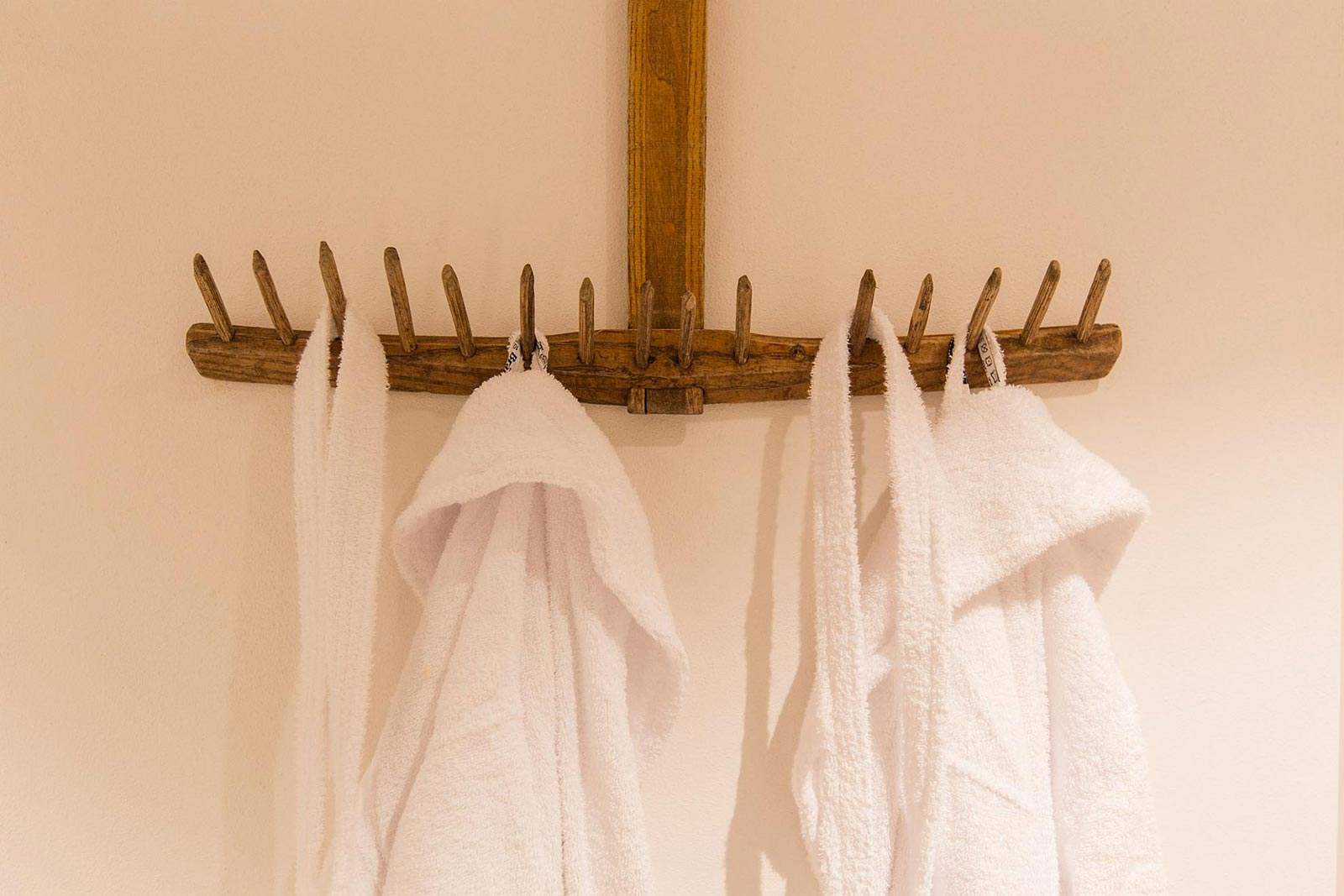 Detail of two bathrobe in the entrance to the wellness centre of the Residence Marteshof
